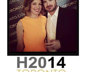 a cute couple pose for a hashtag print