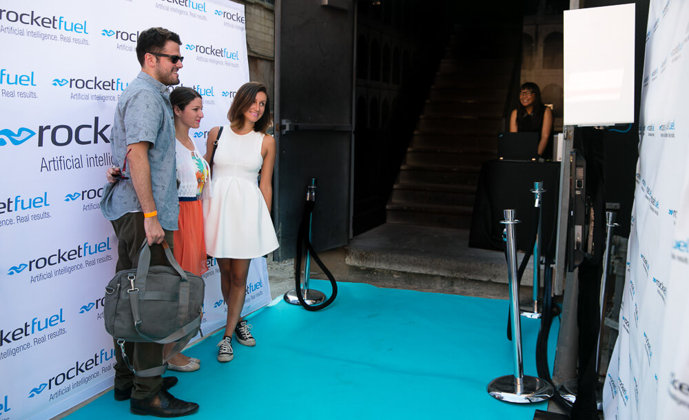 a group posing on the blue carpet