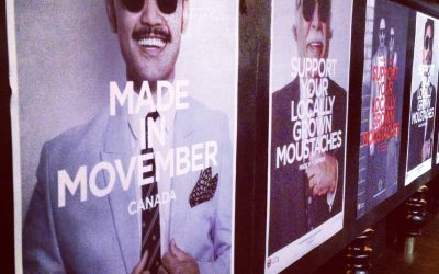 Movember posters on a street in Toronto