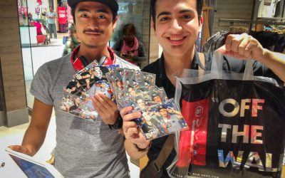 two guys showing their photo booth prints and recent vans purchases
