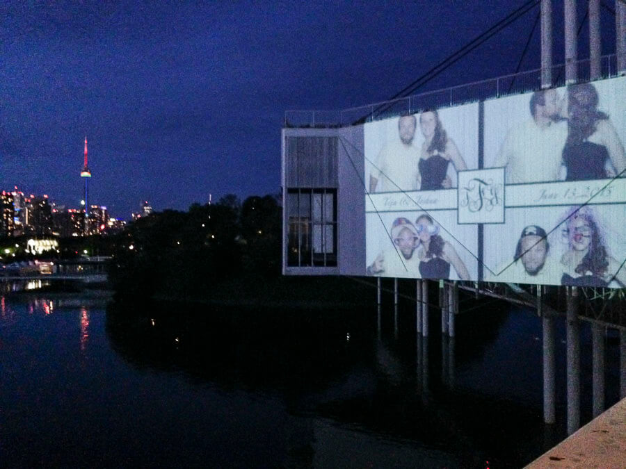 A photo booth photo projected on the side of a building
