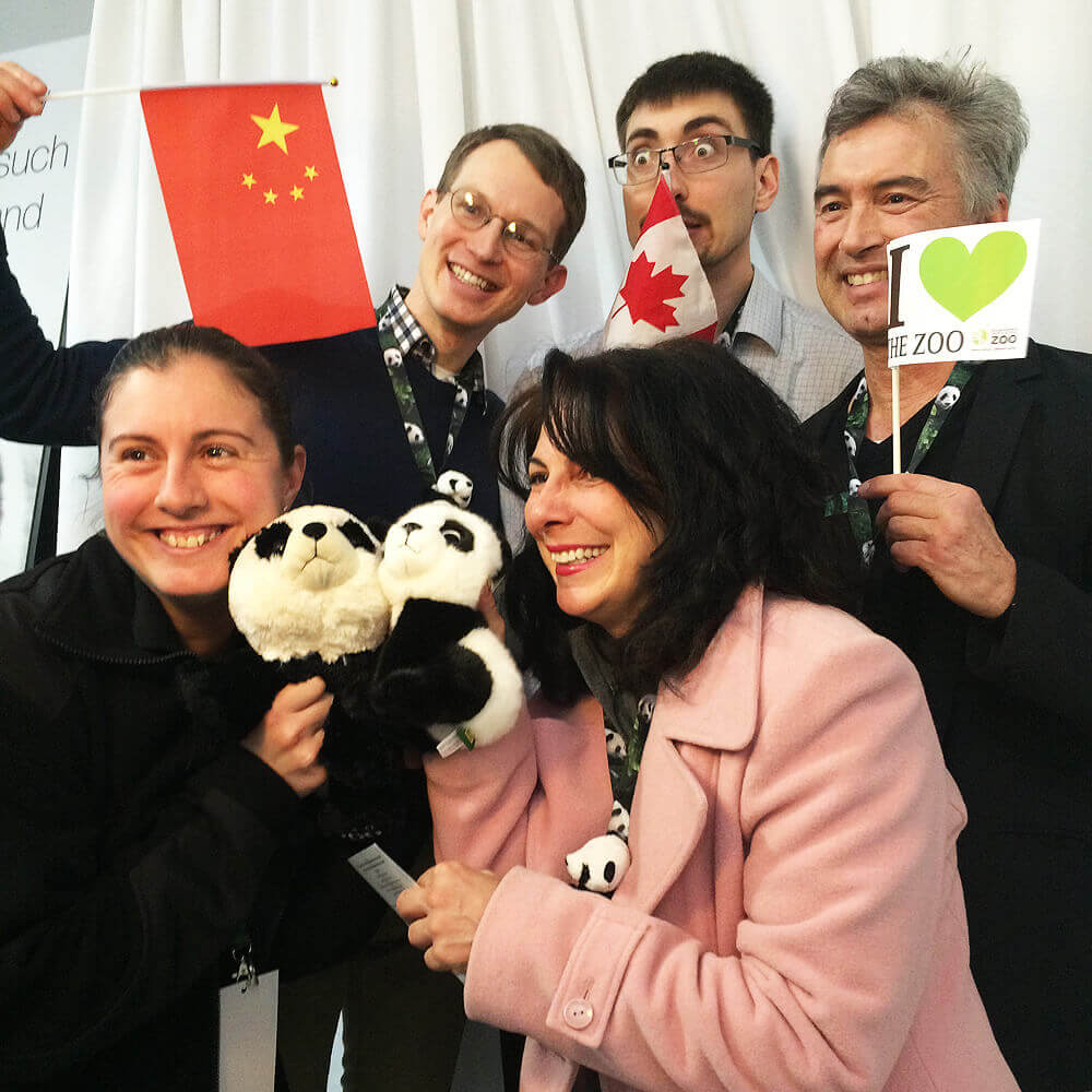 People having fun posing with flags in the photo booth