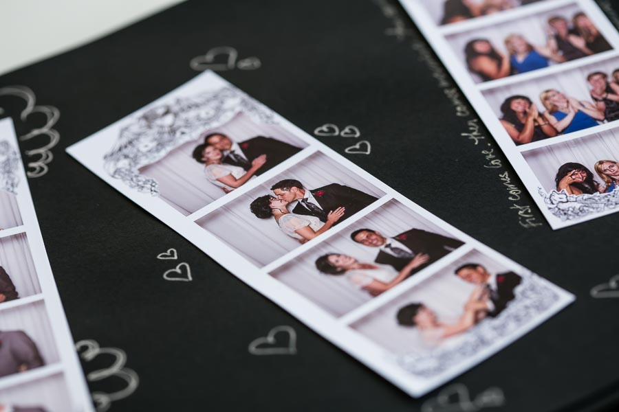 close up of a bride and groom on photo booth strip in an album