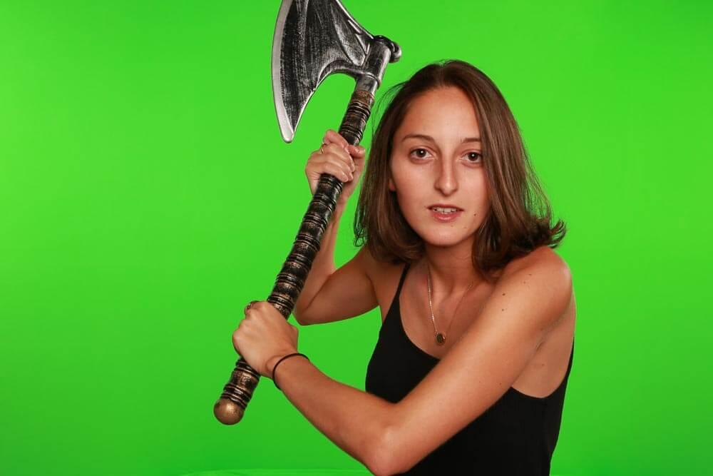 Original green screen image of a woman with an axe