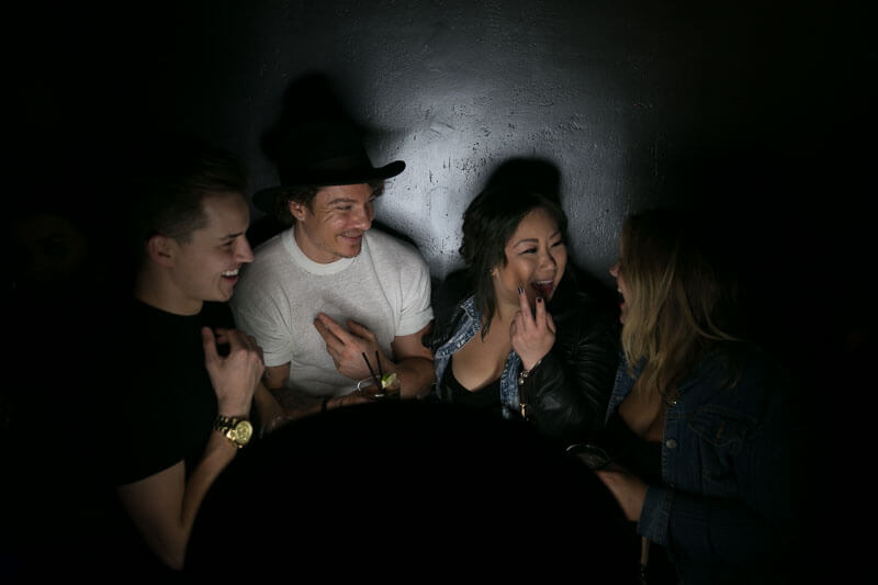 A group talking in the photo booth