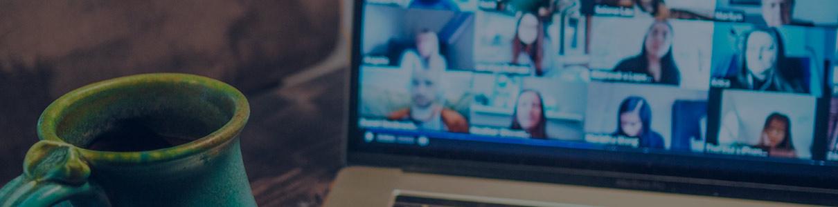 mug of coffee with laptop virtual meeting