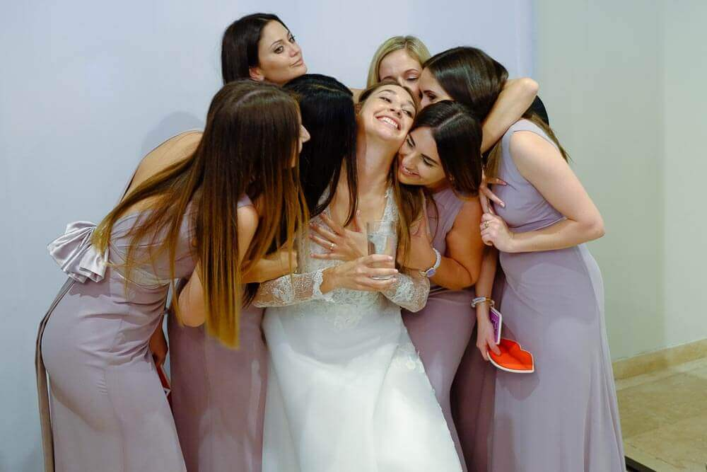 A bride being embraced in the wedding photo booth